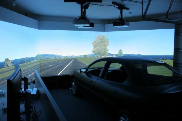 The high-definition full car simulator with operator station on left.