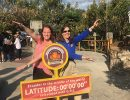 Sarah Siebrandt and Elaine Keane give the Gator chomp at the Equator.