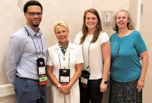 photo of Dr. Luther King, Dr. Sherrilene Classen, Mary Jeghers, and Dr. Sandra Winter at ADED conference