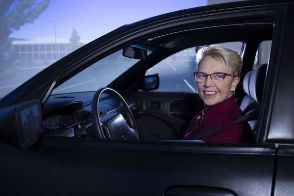 Dr. Sherrilene Classen in UF's full-cab driving simulator.