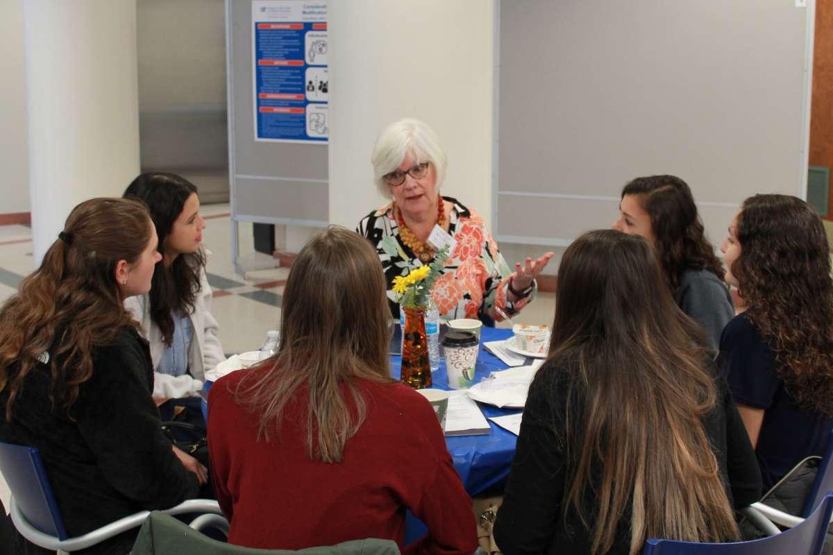 Sandra Edwards speaking with students