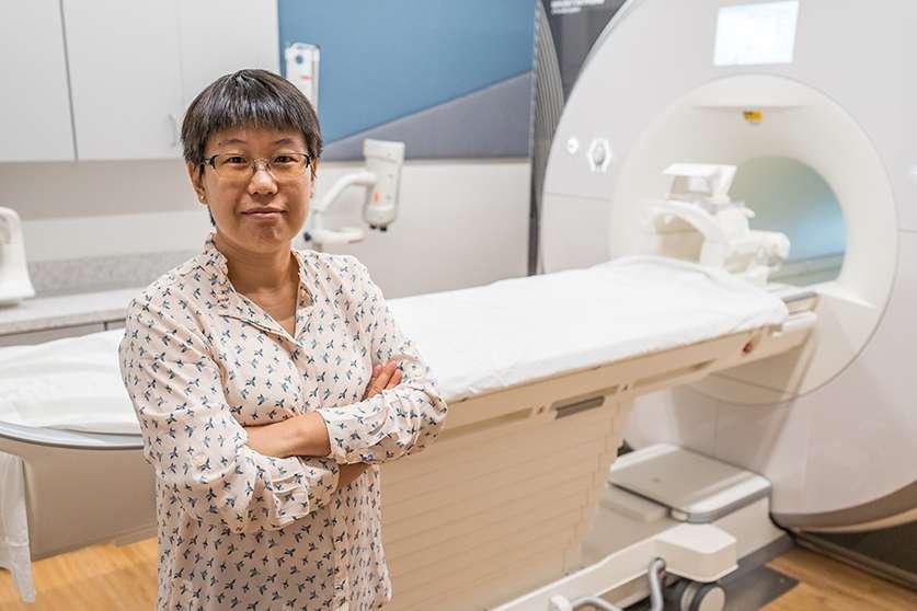 Dr. Zheng Wang with MRI machine