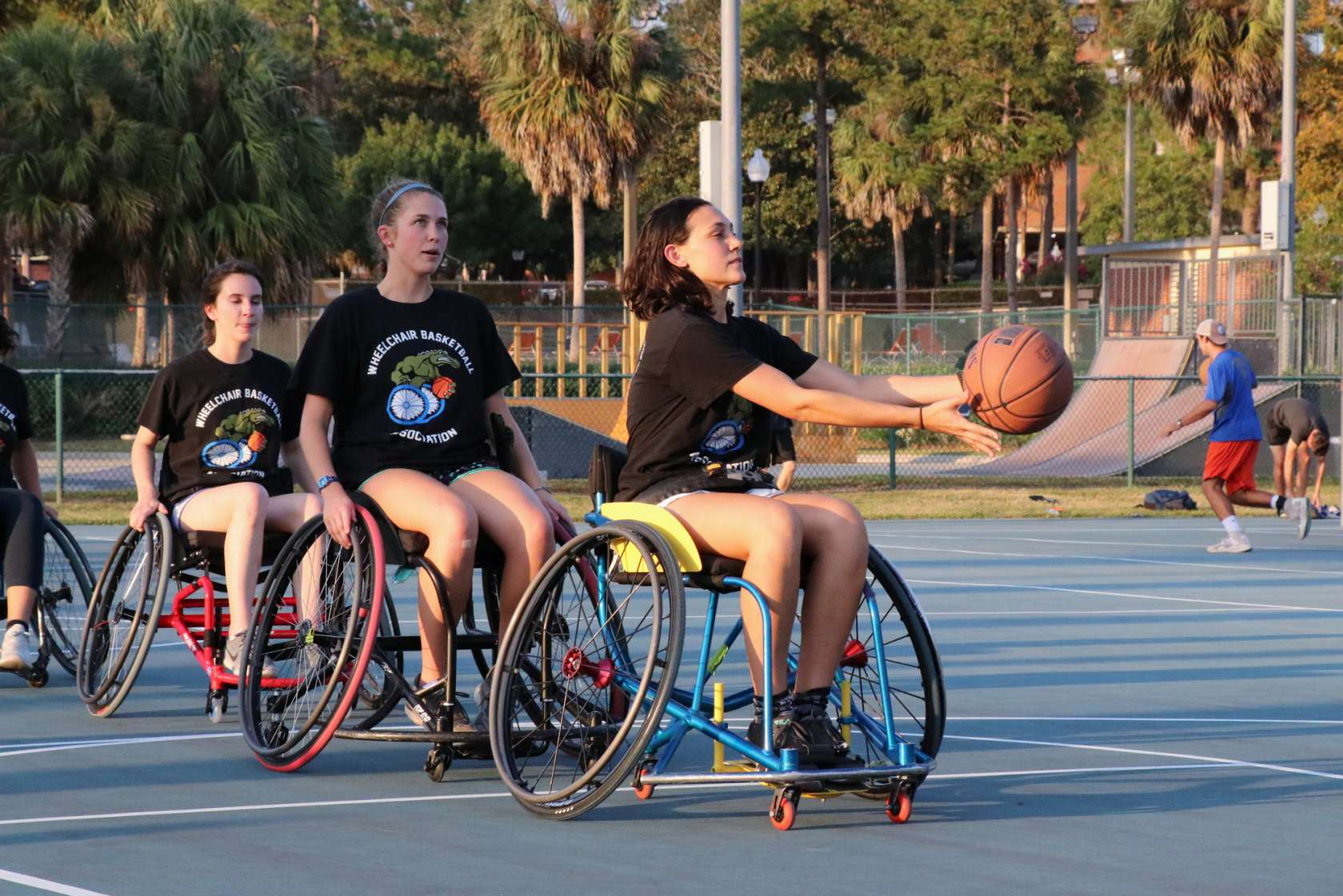 UF students run drills in wheelchair basketball.