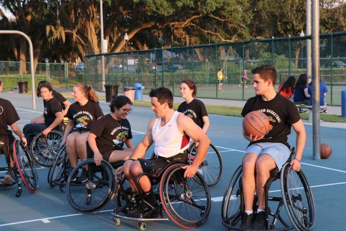 UF students play wheelchair basketball at Broward Outdoor Recreation Complex