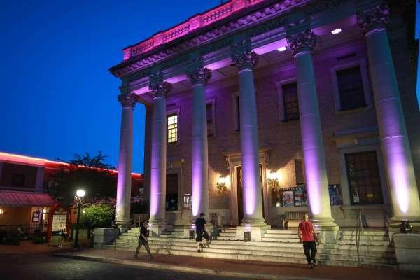 historic Hippodrome building lit at night