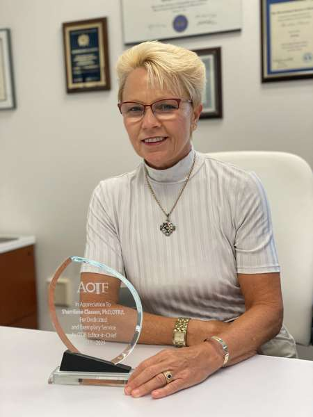 Dr. Classen receives AOTF appreciation for completing 6 year-term as Editor-in-Chief of OTJR