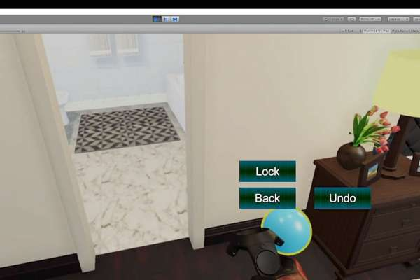 virtual reality view of bedroom and doorway into bathroom with controller for interactions
